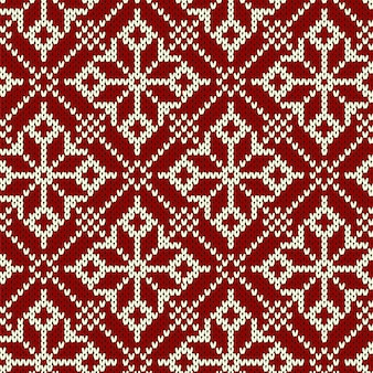 Christmas knitting seamless pattern with geometrical snowflakes.