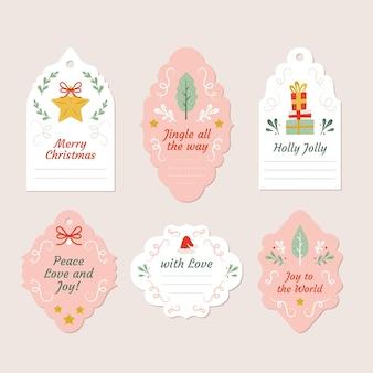 Collezione di etichette natalizie in design piatto