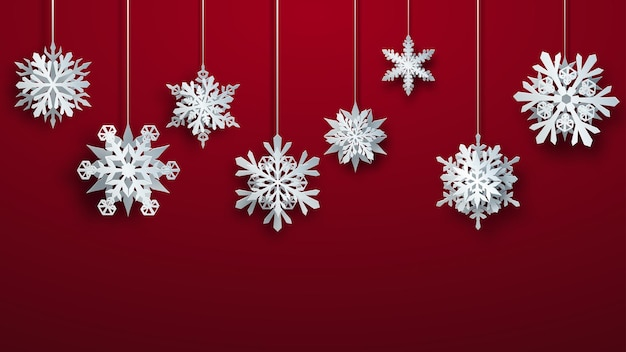 Christmas large complex paper hanging snowflakes on red background