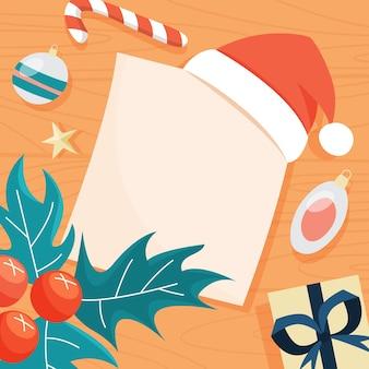 テーブルの上の子供たちからのクリスマスの手紙。空白の紙のリストの上に横たわる赤い帽子。サンタクロースの欲しいものリスト。図