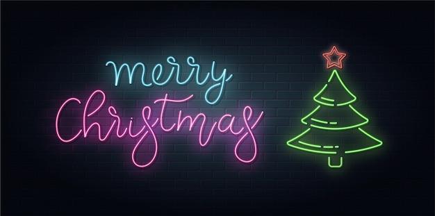 レンガの背景にネオンスタイルのクリスマスのレタリング