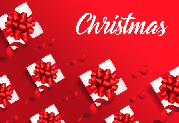 Christmas lettering on red background with gift boxes pattern