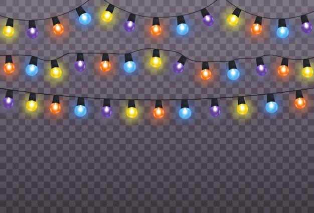 透明な背景に分離されたクリスマスライト。クリスマスに輝く花輪。