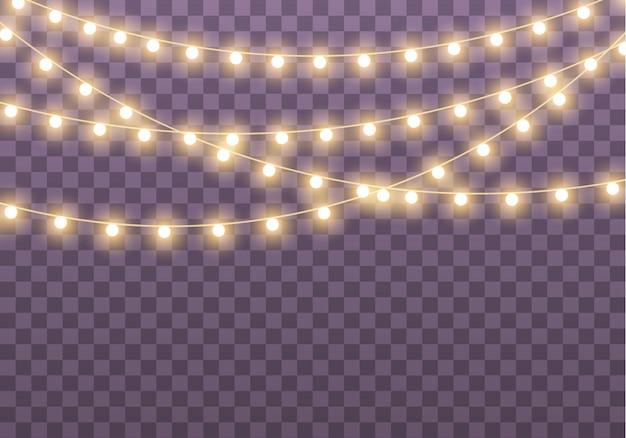 カード、バナー、ポスター、webデザインの透明な背景に分離されたクリスマスライト。ゴールデンクリスマス輝くガーランドのセットは、ネオンランプの図を導いた