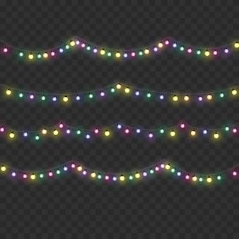 透明な背景に分離されたクリスマスライト。カード、バナー、ポスター、ウェブデザインのための花輪。金色のクリスマスの光る花輪のセットledネオンランプ