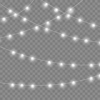 透明な背景に分離されたクリスマスライト。カード、バナー、ポスター用の花輪