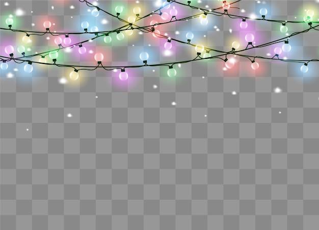 透明な背景に分離されたクリスマスライト。クリスマスの輝く花輪。図