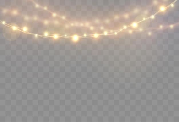 ワイヤーストリングの透明な明るい花輪グロー電球に分離されたクリスマスライト