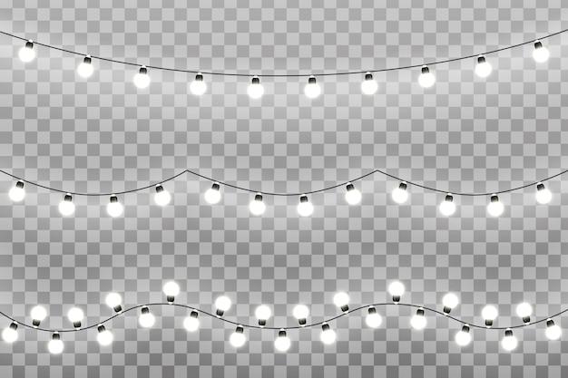 Рождественские огни на прозрачном фоне. светящиеся огни для поздравительной открытки xmas holiday. гирлянды, елочные игрушки. иллюстрация eps10
