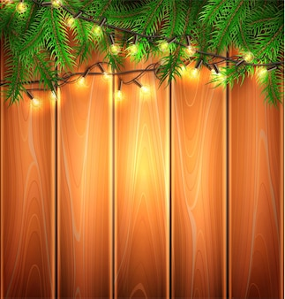 Christmas lights realistic glowing garland with spruce tree twigs on wooden plank backdrop