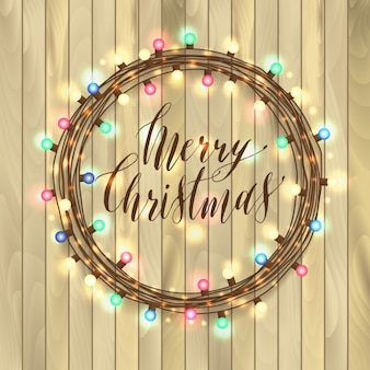 Christmas lights on a wooden background