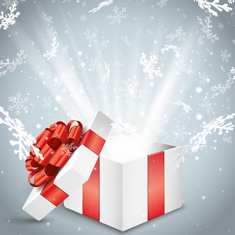 Рождественская волшебная подарочная коробка с блестящим светом и снежинками