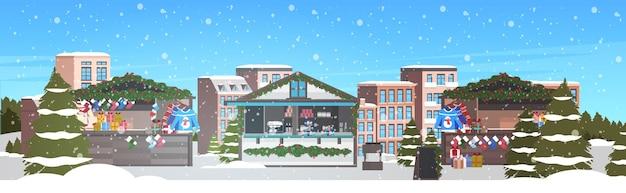 Christmas market or holiday outdoor fair merry xmas winter holidays celebration concept cityscape snowfall
