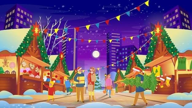 휴일 음식을 사는 전통적인 선물을 쇼핑하는 사람들이 조명하는 크리스마스 시장
