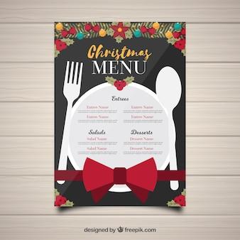 Рождественское меню с блюдами и столовыми приборами