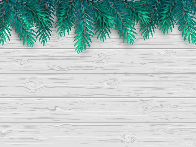 Christmas or new year background with realistic fir branches on a wooden white table.