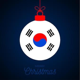 한국 국기와 함께 크리스마스 새 해 공입니다. 인사말 카드 벡터 일러스트 레이 션. 흰색 배경에 고립 된 플래그와 함께 메리 크리스마스 공