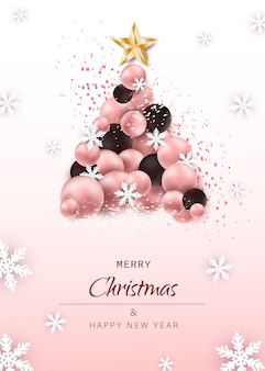 Christmas and new year card. luxury christmas tree made of festive elements such as christmas balls on pink background.