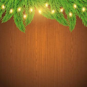 Рождественские или новогодние гирлянды с еловыми ветками на коричневом деревянном фоне вектор зимних праздников