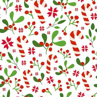 クリスマスまたは新年のシームレスなパターン、花飾り-ヤドリギ、ヒイラギ、キャンディケインの背景