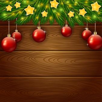 木製の背景に星とクリスマスの装飾