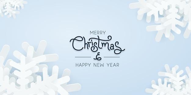 파란색 배경 그림 위에 크리스마스 종이 눈송이