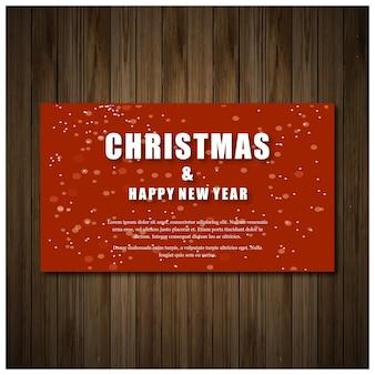 나무 배경에 흰색 인쇄 술과 붉은 색의 크리스마스 파티 초대 카드