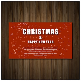 Christmas party invitation card in red color with white typography on wooden background