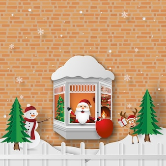 Christmas party with santa claus at the window
