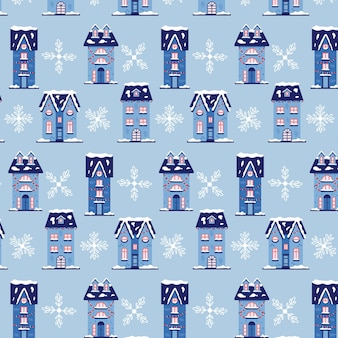 Christmas pattern winter houses with snowflakes. christmas blue background for gift wrapping. modern flat vector seamless illustration
