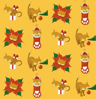 Christmas pattern with a cat playing with christmas elements