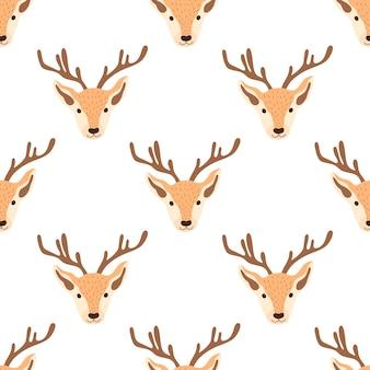 Рождественский образец с головами оленей на белом фоне. векторная иллюстрация