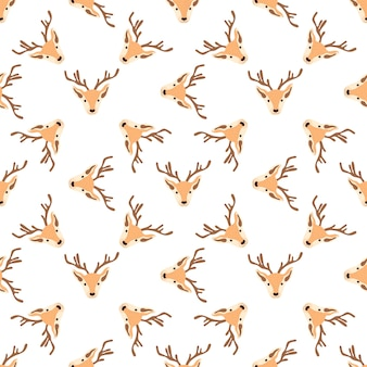 Christmas pattern with heads of reindeers on a white background. vector illustration
