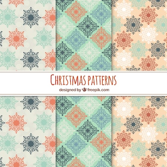 Christmas patterns in soft colours Free Vector