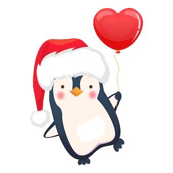 Рождественский пингвин держит воздушный шар.