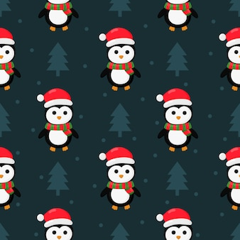 Christmas penguins seamless pattern on blue