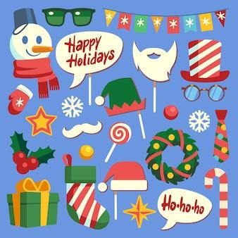 クリスマスフォトブース。休日の小道具サンタの帽子とあごひげ、メガネとギフトボックス。フェイスマスクとエルフの帽子、雪だるまと雪片新年の素敵な装飾セット