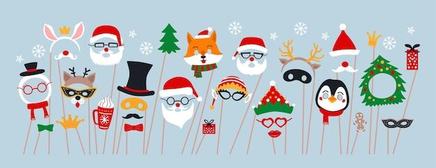 クリスマスの写真ブースの小道具とスクラップブッキングのベクトルセット。サンタ、鹿、エルフ、雪だるまとのパーティーの装飾。