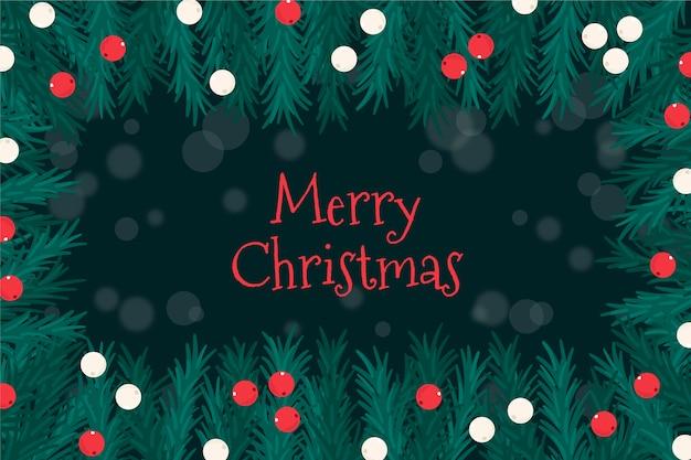 クリスマスパインの葉枝と文字列ぼやけたライト
