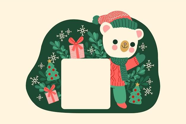 空白のバナーを保持しているクリスマスホッキョクグマ
