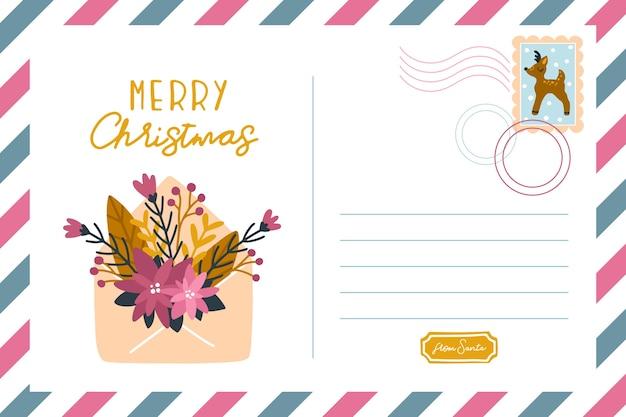 花の封筒が付いているクリスマスのポストカード。手描きイラスト。碑文-メリークリスマス、かわいいイラスト、テキストの場所、鹿のスタンプ。かわいいパステルパレット。