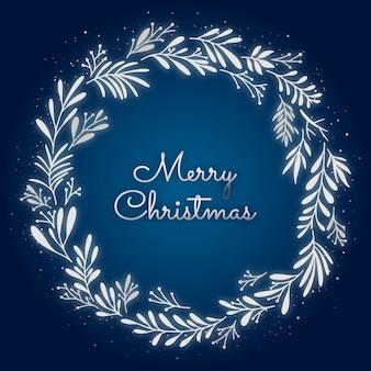 나뭇잎 화환과 눈 덮인 반짝이가 있는 크리스마스 엽서