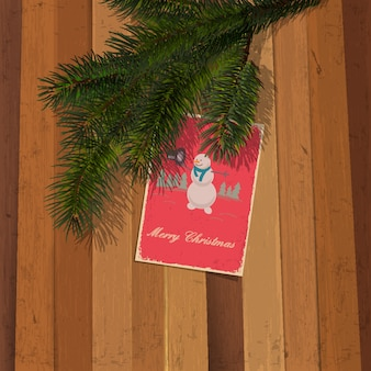 Christmas postcard with snowman on wooden