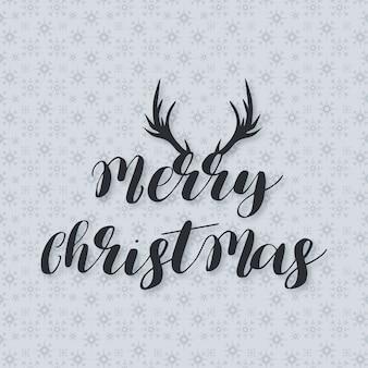 Рождественский плакат, включая творческую типографию с рогами оленей на фоне снежинки