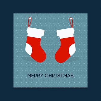 Christmas poster. merry christmas. happy new year. christmas socks hanging on wall. blue background