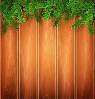 木製の板にクリスマスポスタースプルースの木の枝。
