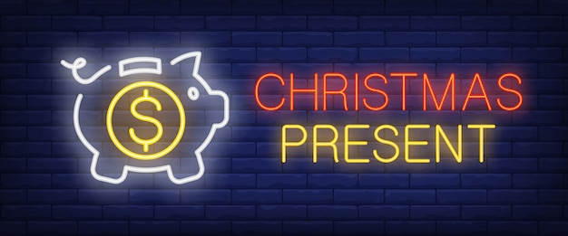 Christmas present neon text with piggy bank and coin