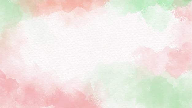 白い空白の紙の背景にクリスマスの赤と緑の水彩スプラッシュ