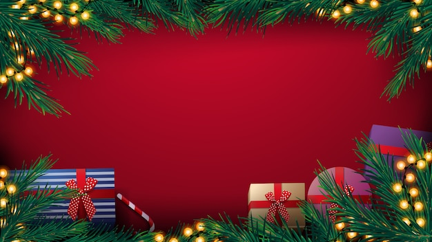 Christmas red background with christmas tree frame with yellow bulb garland and presents, top view
