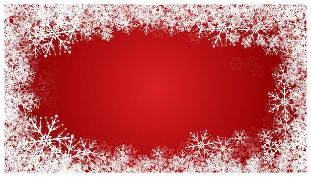 雪片とクリスマスの赤い背景。休日の雪のパターン。